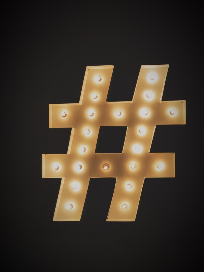 hashtag sign with light bulbs lit up